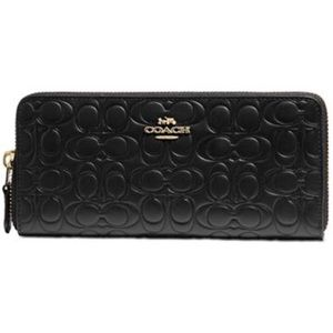 Coach signature embossed leather accordion wallet
